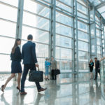 Business-People-Walking-in-Glass-Building