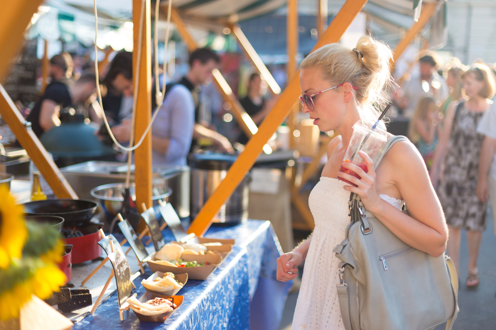 Woman-Looking-at-Food-at-Festival