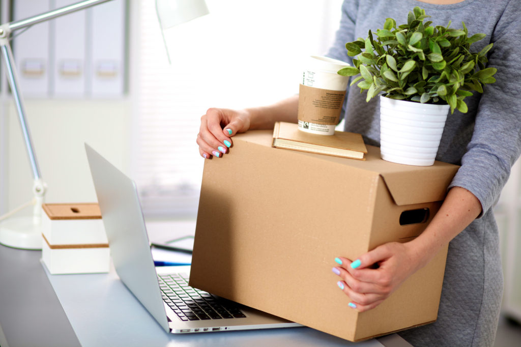 Business-Woman-Packing-Office
