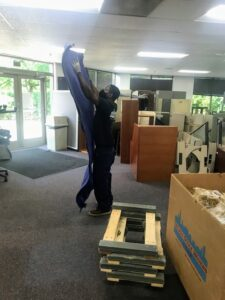 Mover with Moving Blanket Chicago Office Movers