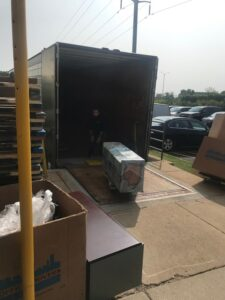 Unloading Office Furniture from Truck