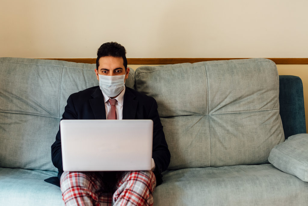 Business Man Working from Home with Mask On